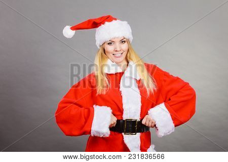 Xmas, Seasonal Clothing, Winter Christmas Concept. Happy Woman Wearing Santa Claus Helper Costume