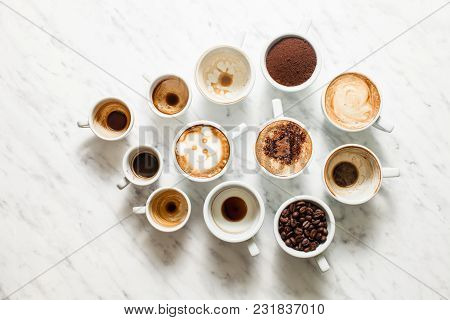 White Cups Of Different Stages Of Preparing Cappuccino, Top View. Cofee Lover Concept Still Life