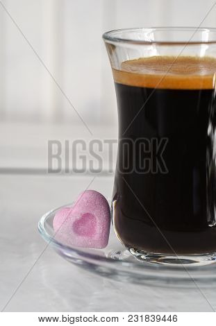 Espresso. Glass Cup Of Espresso With Sugar In The Form Of Heart On A Light Background