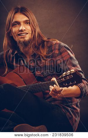 Hobby, Music, Art Concept. Smiled Young Man With Guitar. Sitting On The Floor And Playing The Instru