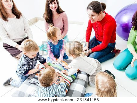 The First Acquaintance Of Children In The Kindergarten. Moms Acquaint Children To Each Other. Moms P