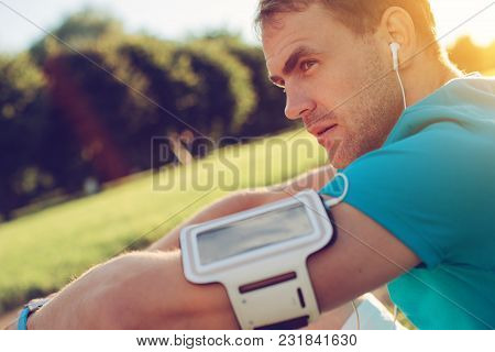 Portrait Of Tired Athlete Resting In The Park, Outdoors