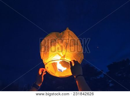 People is launching sky lantern to the sky