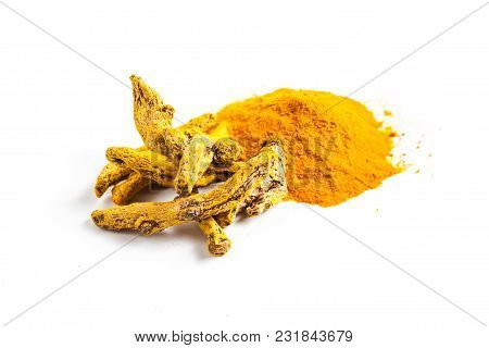 The Turmeric Spice - Powder And Dry Roots Isolated On White