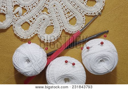 Objects For Sewing. Scissors And Pins. Hanks Thread On Mat. Pins And Scissors On Fabric And Tangles