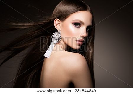 Hair. Beauty Woman With Very Long Healthy And Shiny Smooth Brown Hair. Model Brunette Girl Portrait