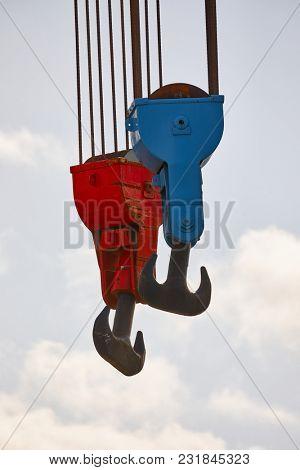 Heavy old steel hooks in a porr