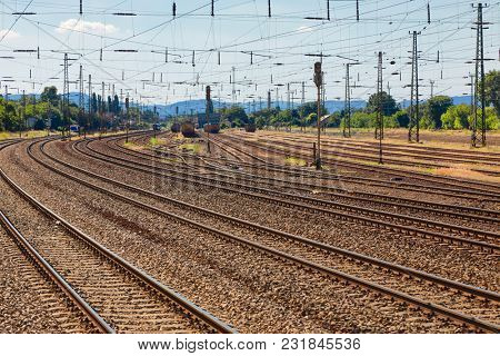 Many railway tracks at a station
