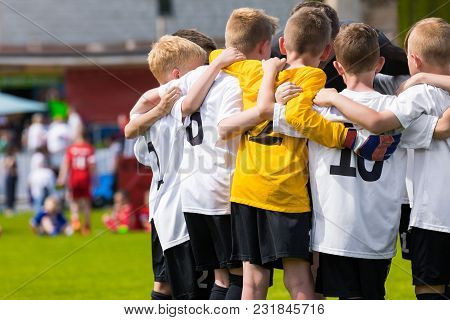 Children Soccer Team. Kids Football Academy. Young Soccer Players In Jersey Shirts Standing Together