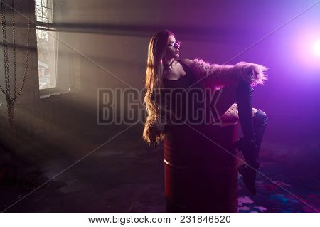 Young Seductive Woman, Portrait In Darkness. Girl In Stylish Pink Fur Coat And Glasses. Smokey Backg