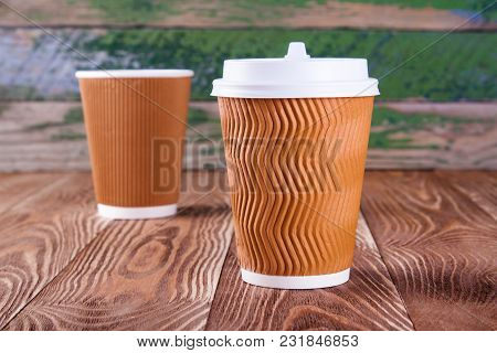 Disposable Brown Cup On Wood Desk. Food Objects