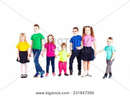 Children Of Different Ages Are Standin And Holging Hands, Wearing In Rainbow T-shirts, Isolated On W