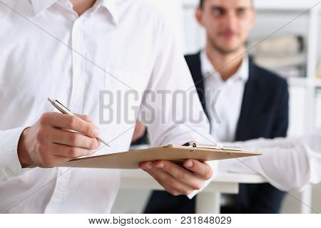 Male Arm In Shirt Hold Silver Pen And Pad Making Note In Office Closeup. Deal Consult Delivery Signa