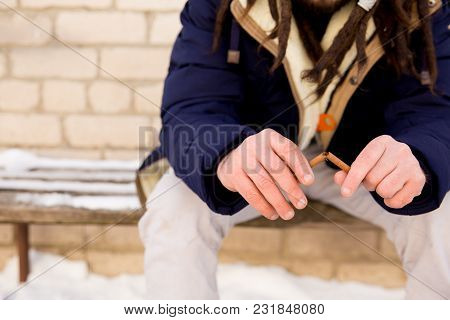 Quit Smoking Concept - Man Breaks A Cigarette