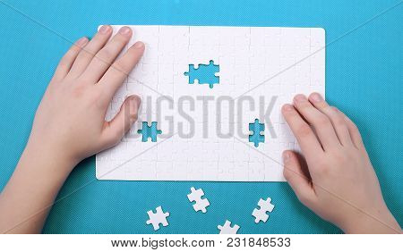 White Details Of Puzzle On Background. A Puzzle Is A Puzzle From Small Pieces. Heart Shape Of The De