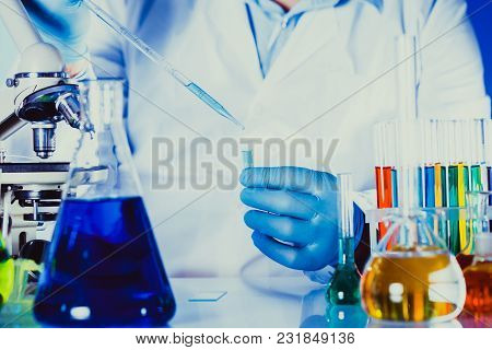 Scientist Holds Eppendorf Tube And Pipette. Focus On Test Tube