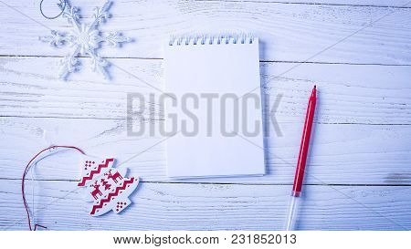 Workplace With A Diary, Decorations And Gifts. New Year's List O