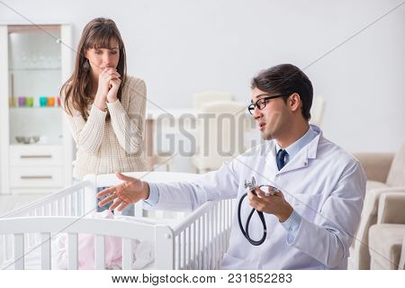 Doctor explaining to young mother