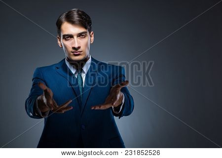 Businessman pressing virtual buttons on gray background