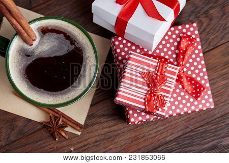 Still Life With Cup Of Coffee Holiday Gift In Small Red Color Box With Pattern, Covered With Red Rib