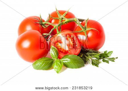 Tomatoes On The Branch And Herbs Isolated On White Background