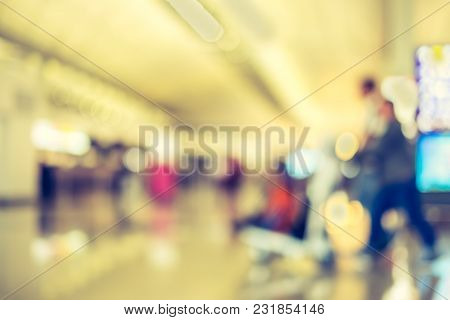 Blurred Background,traveler With Baggage At Terminal Departure Check-in At Airport With Bokeh Light,