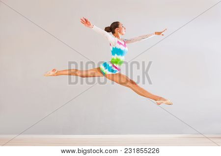 Flying Gymnast Woman In Colorfull Tricot Clothes