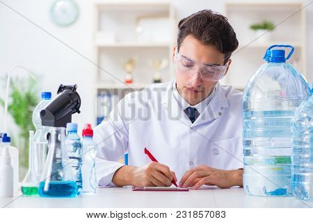Lab assistant testing water quality
