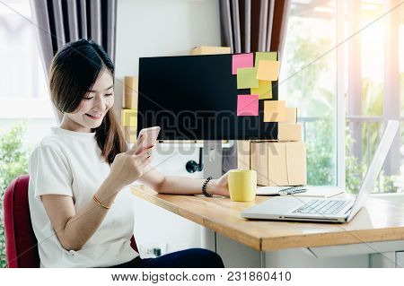 Young Asian Girl Is Freelancer With Her Private Business At Home Office, Working With Laptop, Coffee