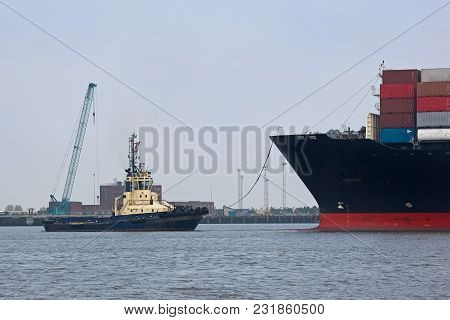 Container Ship Entering Harbour With A Tug