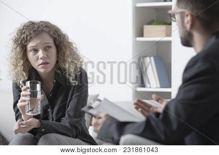 Young Woman Talking To Psychologist