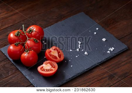 Seasoning Vegetarian Still Life With Fresh Grape Tomatoes, Red Pepper And Cooking Salt In Wooden Spo