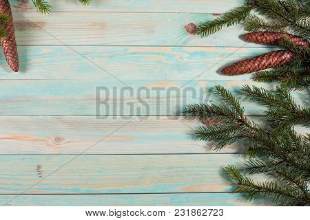 Christmas Background With Spruce Branches On Wooden Board With Copy Space