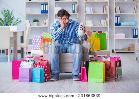 Young man after excessive shopping at home