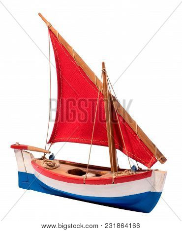 Colorful Wooden Sailing Boat With Red Sail
