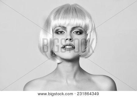 Sexy Glamour Girl Or Woman With Fashionable Makeup On Pretty Face And Short Hairstyle Or Pink Wig In