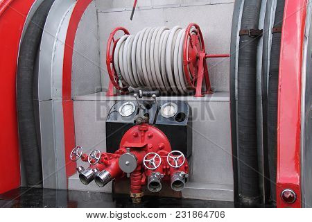 A Hose And Valves At The Rear Of A Vintage Fire Engine.
