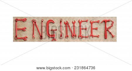 An Engineer Sign Made From A Mix Of Painted Tools.