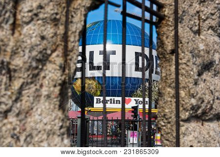 Berlin, Germany - April 19, 2017: View Through An Opening Of  The Infamous Berlin Wall At The Topogr