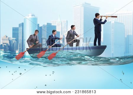 Team of businessmen in teamwork concept with boat