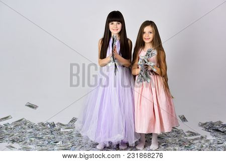 Little Girls Sisters With Money, Dollars, Savings. Credit, Business Success, Future, Fortune. Curren