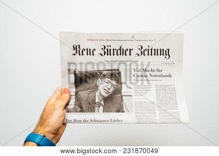 Paris, France - Mar 15, 2018: Pov At Swiss Neue Burcher Zeitung Newspaper With Portrait Of Stephen H
