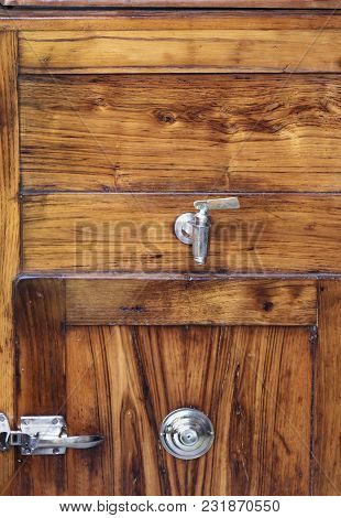 Wooden Background  With Silver Hinge And Knob