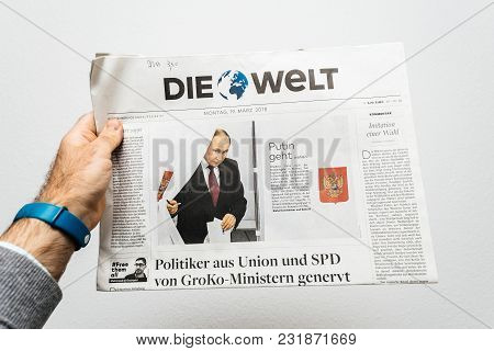 Paris, France - Mar 19, 2017: Man Reading German Die Welt Newspaper At Press Kiosk Featuring Russian