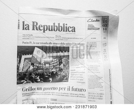 Paris, France - Mar 19, 2017: Man Reading Italian La Republica Newspaper At Press Kiosk Featuring Ru
