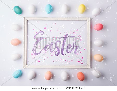 Easter Phrase And Eggs On A White Background. Studio Shot. Flat Lay.