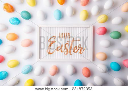 Hello Easter Phrase And Eggs On A White Background. Studio Shot. Flat Lay.