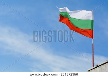 Bulgarian Flag Waving Against Vibrant Blue Sky.