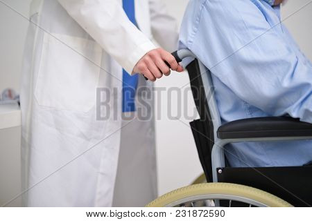 Nurse pushing a patients wheelchair