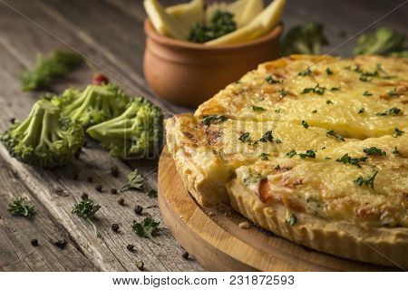 Fresh Vegetable Pie Served On A Cutting Board On Rustic Wooden Table. Selective Focus On The Pie